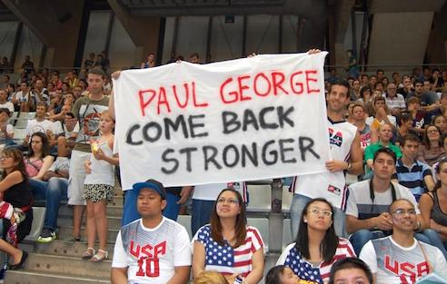 Fans all the way in Barcelona, Spain show their support for Paul George.